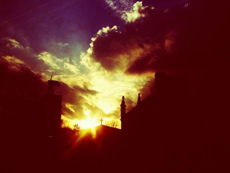 Sun setting behind the church in London