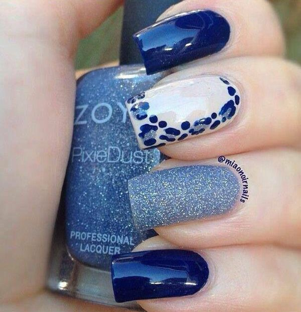 A strong combination of blue colors and designs. Each nail sports a unique design from matte to glitter and to leopard prints.