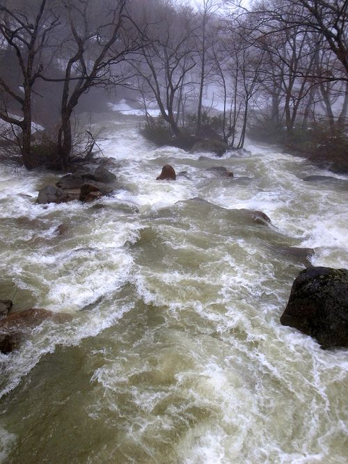 Floods Storms:  A river overflows its banks and floods the surrounding countryside.
