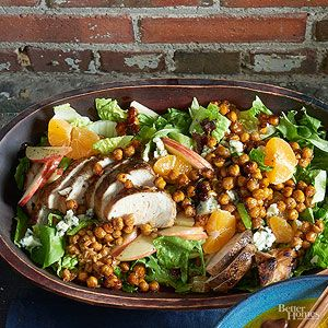 Candied chickpeas give this salad sweet crunch. A trio of seasonal flavors like apple, clementine, and cranberry finish off the bowl./