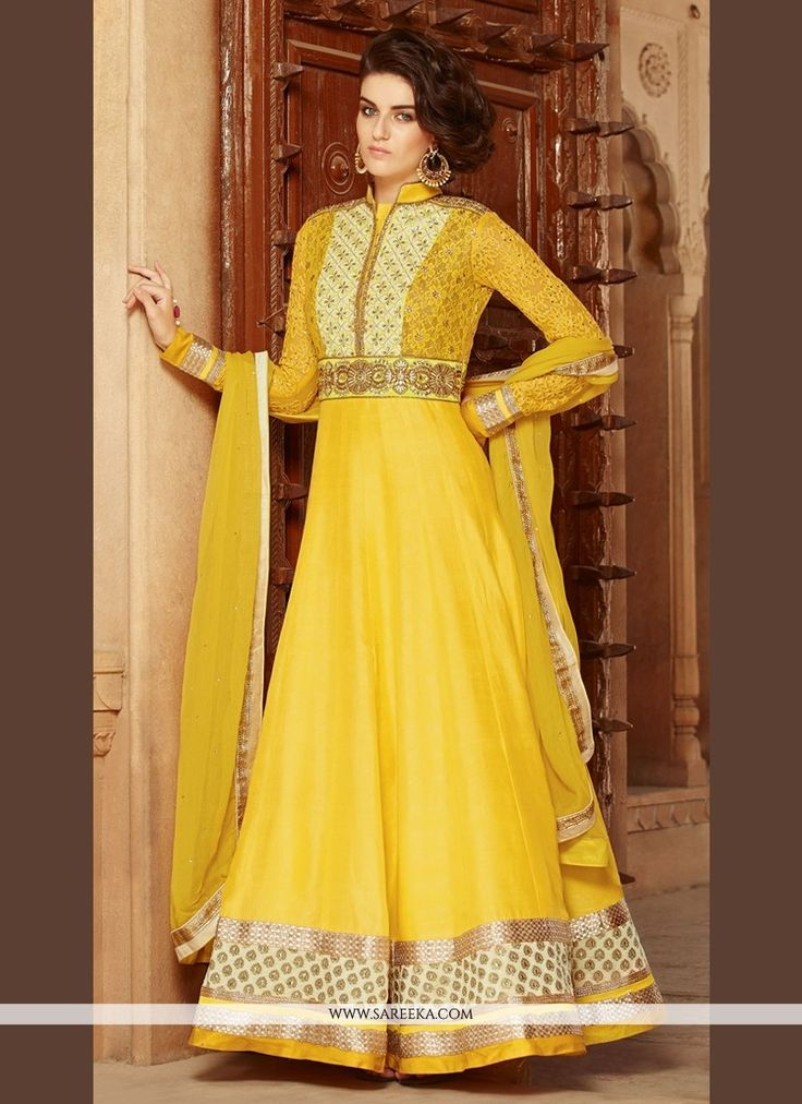 This yellow georgette anarkali salwar kameez is adding the pretty glamorous showing the feel of cute and graceful. The attractive embroidered and patch border work across the dress is awe inspiring. C...