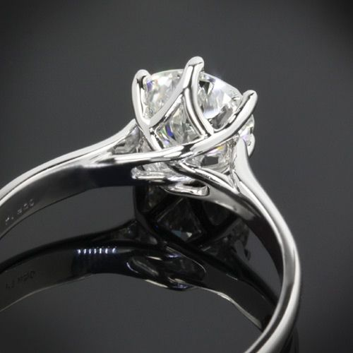 Swan Solitaire Engagement Ring; I am in love with the setting and if I could get it in yellow gold I would