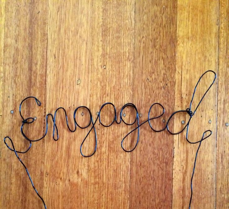 "This was originally going to be a cake topper though I thought it would clash if it was in the cake so we bent the wire and made it a little front centre piece for the cake . Wire ""engaged"" sign  I made this my self, buying the wire from a local craft store. I literally started with the first part of the wire and just kept bending it to shape of each letter. The key is my to manipulate the wire to much as you want a clean finish. One you have completed all letters then cut the wire  You…"