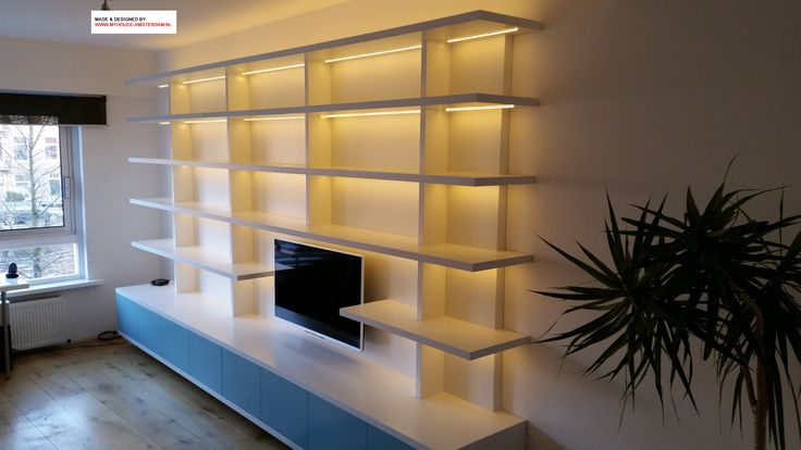 Modern bookcase with led lights - Moderne boekenkast met ledverlichting en plaats voor TV - door www.myhouse-amsterdam.nl