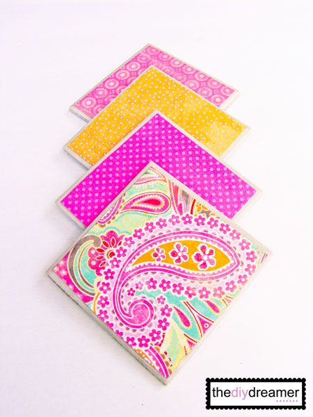 DIY coasters: Buy tile, add modge podge and scrapbook paper, then spray with acrylic spray paint. Great for housewarming gifts :) Thanks for the idea @Maria Neves Hamner!