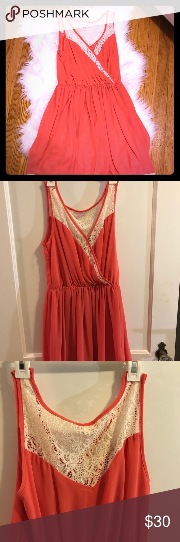 A coral lace dress A coral dress with lace detailing on the bottoms, back and top Dresses Midi