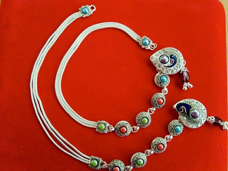 designer silver plated brooch payal anklet with peacock design meena work