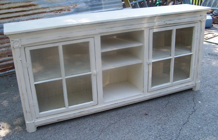Handcrafted using old windows for doors.  Great for a very large flat screen tv.  https://www.facebook.com/shabby.antiques