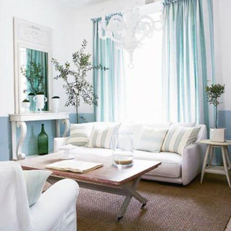 Nice calm colors. Note light fixture, painted end table, shelf/mirror unit