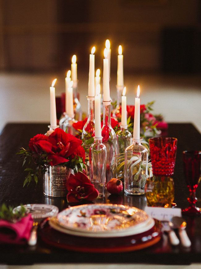 dark red holiday inspiration dramatic Christmas tablescape in shades of red, cream, gold and green with a touch of old world charm and an abundance of candles