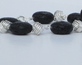Bracelet with stone beads and handmade silver links.