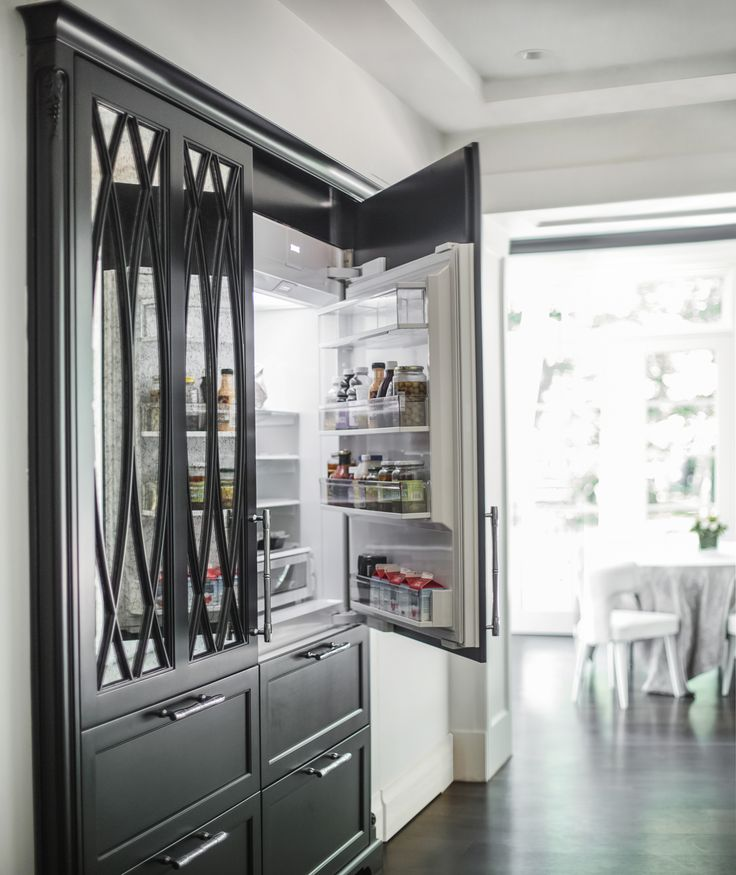 black kitchen with two subzero refrigerators paneled to look like armoire woodmode kitchen. Black Bedroom Furniture Sets. Home Design Ideas