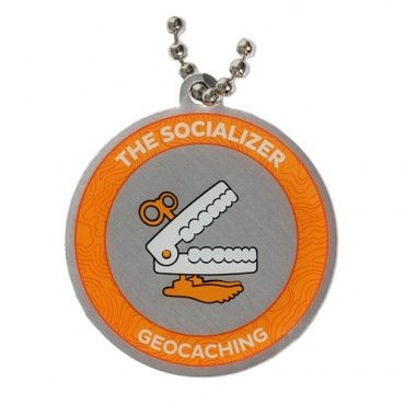 7SofA Travel Tag: The Socializer $5.50 USD  Every day, there's a new adventure out there- and you can't wait to find it. For every geocache you find, you earn two smileys: the one on your profile and the one on your face.  If this sounds like you or someone you know, celebrate with this cool Socializer tag! The tag comes with a chain for hitchhiking!  Attend an Event Cache, Mega-Event or Giga-Event to unlock the Socializer souvenir.