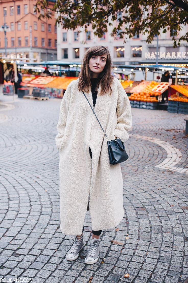 POLIENNE | in Stockholm, wearing a MONKI sheep coat, H&M leather trousers, CONVERSE sneakers & COACH bag