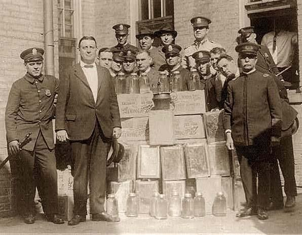 Prohibition  A group of Policemen with cases of moonshine in Wash.D.C. 1922