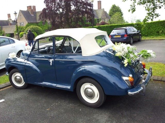 1960s Morris Minor decorated with bunches of gypsophila