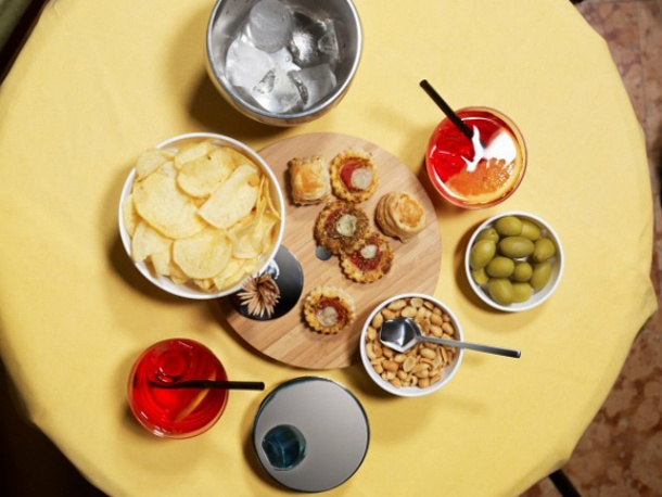 Olives, chips, peanuts in Alessi style by Giulio Iacchetti
