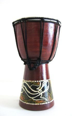 """Djembe Drum, Bongo Percussion African Drum, 9""""H by World Bazaar Imports. $23.99. Handcarved by skilled artisans - MEDIUM SIZE PROFESSIONAL QUALITY. Perfect for any music lover. Fair Trade Item. Features a genuine goat skin drum head. Produces a nice resonating sound - Professional. Traditionally used in Balinese rituals and ceremonies, the Djembe drum has become synonomous with drumming circles around the globe. Hand carved out of a single piece of hardwood, these instrume..."""