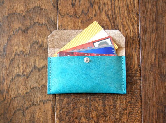 This item is a beautiful business card holder made with top grain this item is a beautiful business card holder made with top grain vegetable tanned leather dying in turquoise hand stitch and handmade with eco friendly reheart Images
