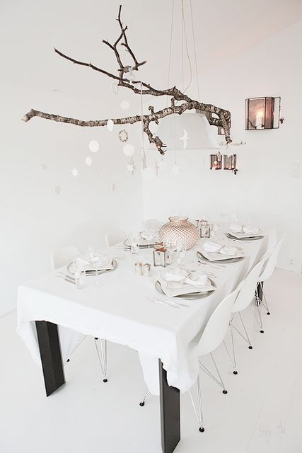 The branch over the table is genius and looks awesome...you could change up the decor hanging from it any time, like the holidays!