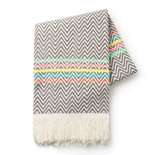 We LOVE this stylish chevron print throw with the added pop of on trend neon stripes going through it and a frayed rim.