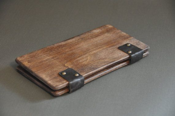 Solid wood check presenters with your choice of antiqued brass hinges, leather hinges or a leather strip as the spine. The leather I use is sourced