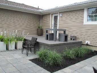 Deck, patio, black mulch, grasses, modular furniture, modern planters. Completed by Leaf Garden Design Inc.  | oakdale Rd
