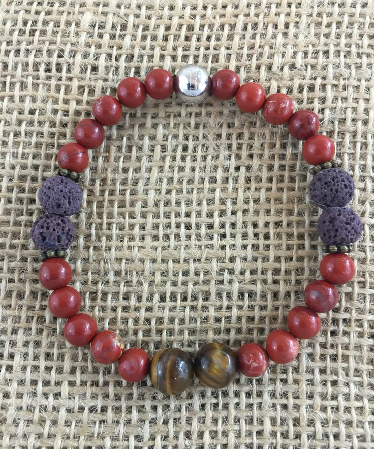 A personal favorite from my Etsy shop https://www.etsy.com/listing/256536067/bracelet-red-jasper-tiger-eye-8mm-stone