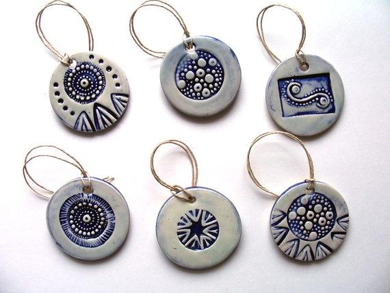 'Tis the season! Ceramic ornaments made using handmade original stamps.