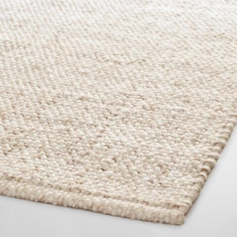 Saw this one in the store too-- I like that it's wool, which is better for pet stains (like cat vomit!) than sisal or jute.