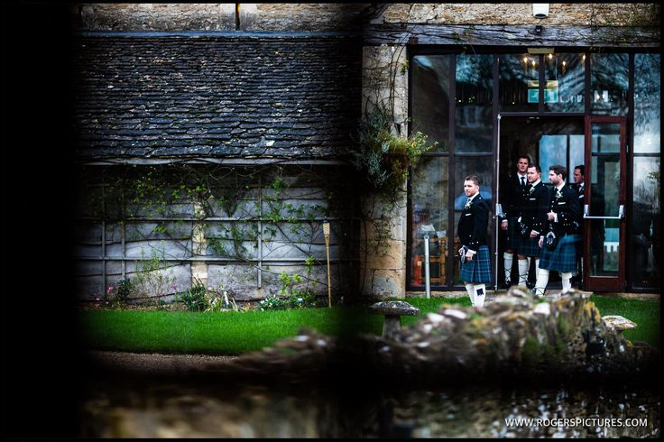 Kilt clad groomsmen at The Great Tythe Barn in the Cotswolds, more here -