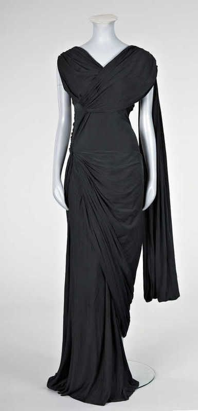 An interesting Jeanne Lanvin black silk jersey `Goddess' gown, probably late 1930s or 1940s, with large woven silk label, numbered 2590.5, z...