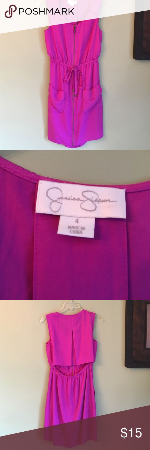 JESSICA SIMPSON PURPLE ZIP UP DRESS JESSICA SIMPSON PURPLE ZIP UP DRESS. Open back detail. Zip up with front pockets and tie. Looks pink in the pictures but more of a purple color. 35 inches from top to bottom. Jessica Simpson Dresses Mini