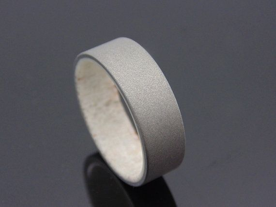Hey, I found this really awesome Etsy listing at https://www.etsy.com/listing/190961266/antler-and-titanium-ring-mens-titanium