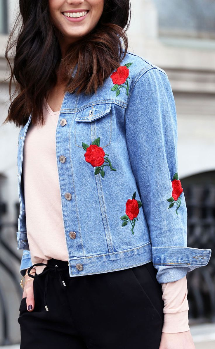 style embroidery in the spring: embroidered flower denim jacket. perfect casual style with black joggers