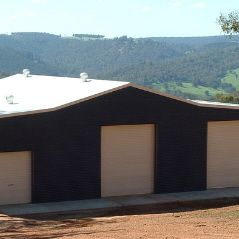 'Aussie' barn with large roller doors for horse float access.