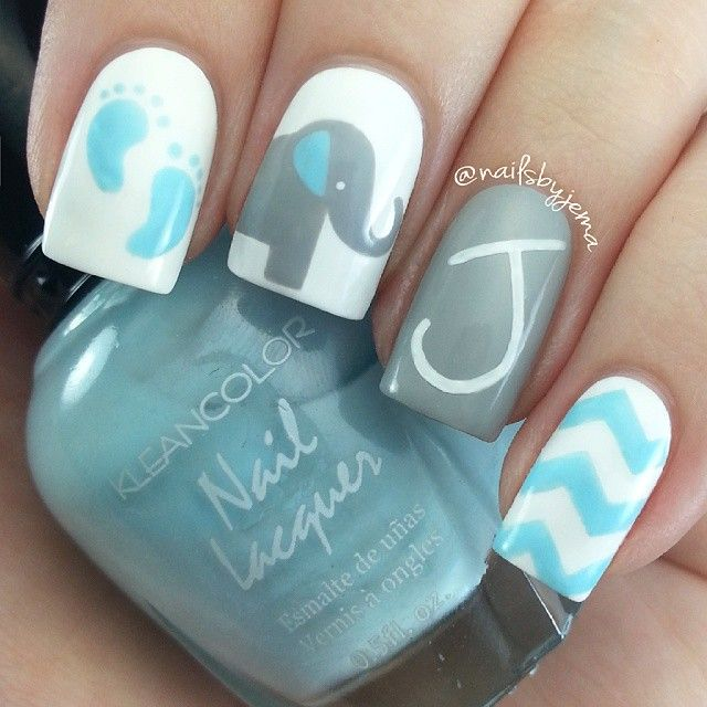 Instagram media by nailsbyjema - These were inspired by the birth of @d4cmusic & @becs09's beautiful baby boy Jordan James Solomon a week ago today! I took inspiration from Bec's beautiful baby shower invitations :) I'm so happy for you both ♡♡♡ Polishes used: OPI 'Alpine Snow', Kleancolor 'Pastel Blue' & Maybelline 'Audacious Asphalt'. Chevrons done with tape and pinking shears, art done with nail art brushes from eBay and dotting tools and the 'J' was done with my Signo Uniball gel pen.