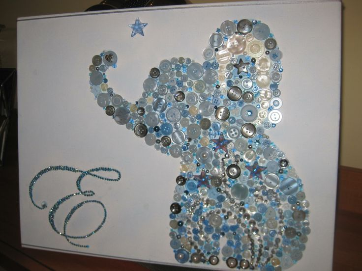 "A unique Coushi Creation,custom canvas artwork ,""Elephant Button Canvas incorporating a mixture of material as buttons,crystals,beads rhinestones to create this beautiful baby boy theme design. Coushi Creations creating personalised art  gifts"