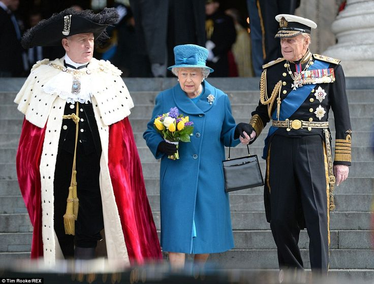 The Queen leaves St Paul's Cathedral with Prince Philip and the Lord Mayor of London following a service to commemorate those that fought in the Afghanistan war