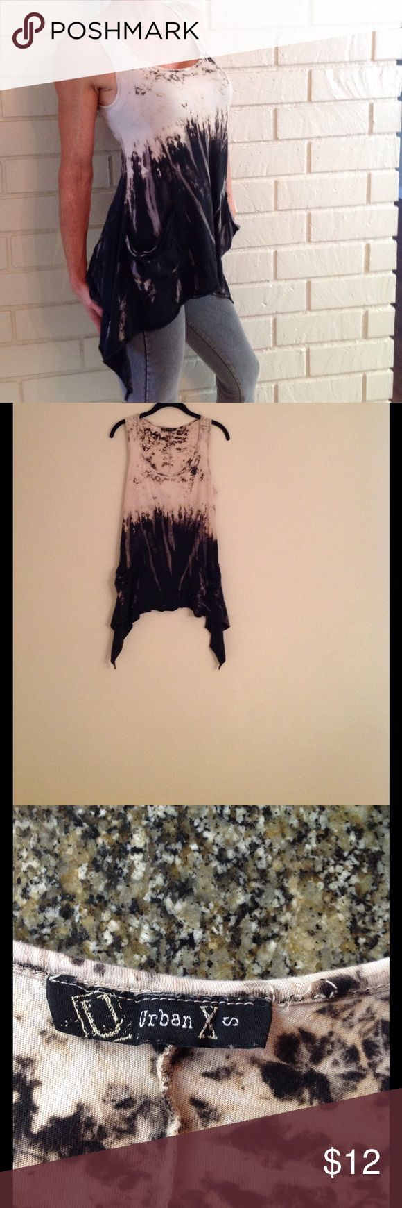 Urban X Tie dye Shirt Bundle of 3 Urban X brand tie-dye shirt bundle of 3 shirts! 1st is black & white boho chic style, 2nd is Tan and black tie dye shirt, Size small but loose fitting, Has front pockets and high low hem on sides. 3rd is blue with some rhinestones missing so I'm really throwing this in for free! Great with skinny jeans for summer. All 3 for this price! Urban X Tops Tunics