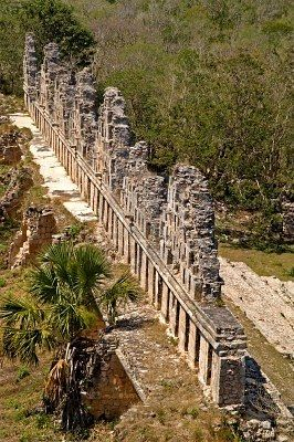 Mayan ruins at the south side of Uxmal, the house of the doves as seen from the top of the great pyramid, Uxmal, Yucatan, Mexico