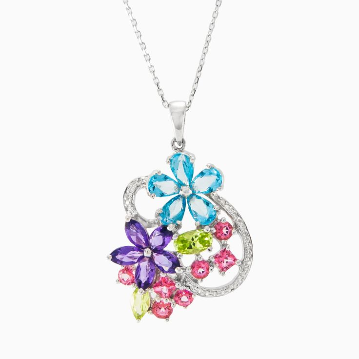 Very attractive pendant handcrafted in 18k white gold with natural diamonds, topaz, amethyst, peridot and rose quartz. All gemstones together make an incredible spring mood.