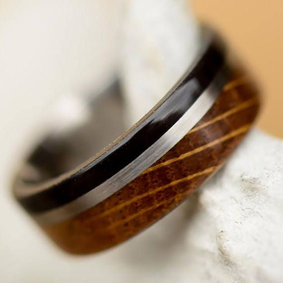 Men's Wedding Band: Jack Daniels Barrel Stave Wood and Buffalo Tusk Divided by Metal line. outdoor staghead, staghound