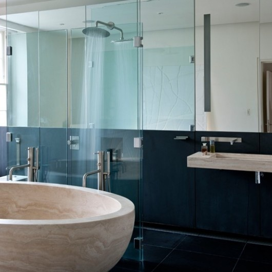 Modern huge bespoke tub. This teal colour is so lovely with neutrals, stone finishes and glass.