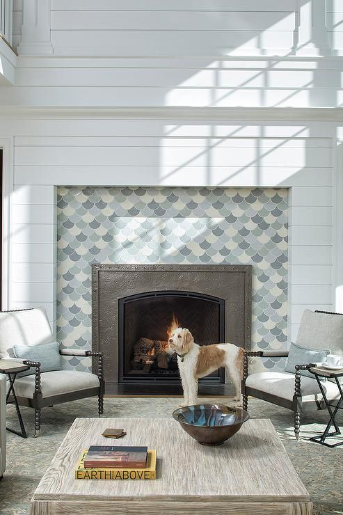 Large White Fireplace Mantel Displays Blue And Gray Mosaic Accent
