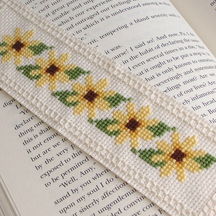 http://www.etsy.com/listing/130316437/bookmark-sunny-yellow-flowers?ref=sr_gallery_14_search_query=cross+stitch+bookmarks_view_type=gallery_ship_to=KW_explicit_scope=1_page=14_search_type=handmade