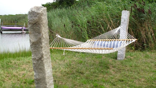 Salvaged Granite Makes Great Hammock Posts Garden
