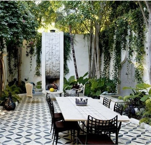 A very cozy backyard patio getaway... I like the paving pattern... although more comfortable seating at the fireplace would be in order.