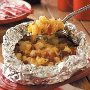 Cheesy grilled potatoes Ingredients 3 large potatoes, peeled and cut into 1-inch cubes 1 medium onion, chopped 3 tablespoons grated Parmesan cheese 1 tablespoon minced chives 1/2 teaspoon seasoned salt 1/4 teaspoon pepper 2 tablespoons butter 1/2 cup crumbled cooked bacon 1/2 cup shredded part-skim mozzarella cheese 1/2 cup shredded cheddar cheese