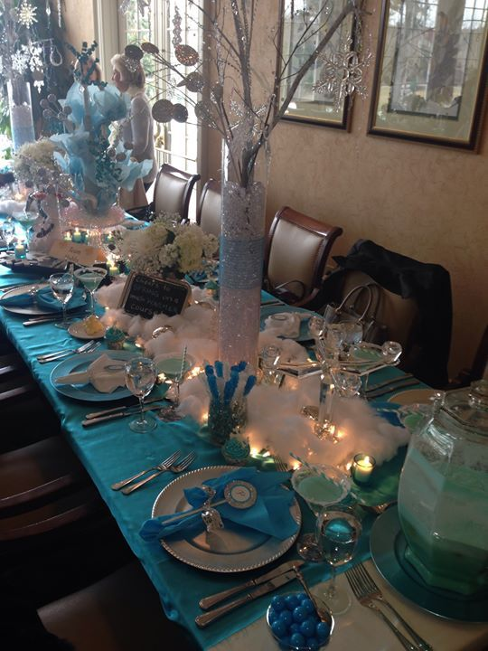 Frozen party theme- glitter spray paint branches for table decor
